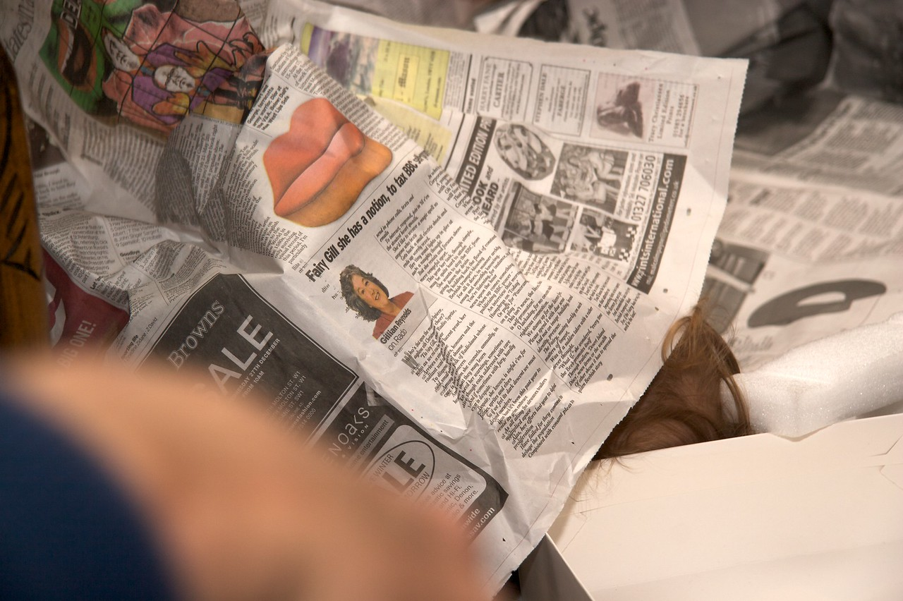 Hidden • That tuft of hair sticking out from under the newssheet is Edmund, who enjoyed rolling among the newspaper I'd used to wrap Christmas presents.