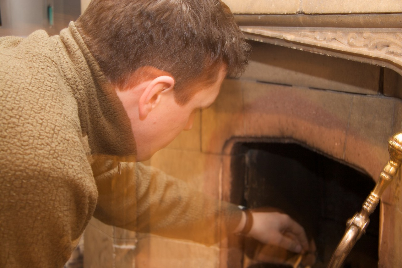 Laying a fire • John setting the foundations for a roaring fire in the drawing room.