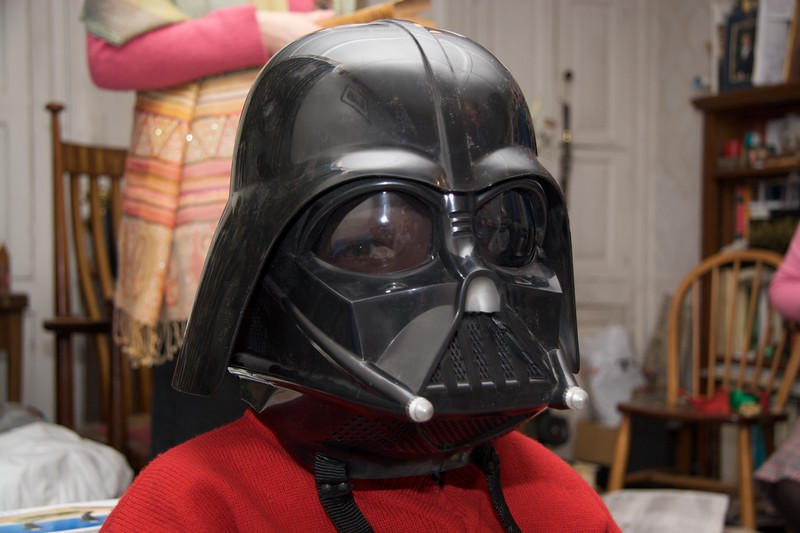 Darth George • George wearing the Darth Vader helmet which I had given to Samuel.