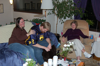 Curtis (center) after eating way too much for dinner.  Wife Elizabeth (left) and Grandma Schneider (right) tease him.