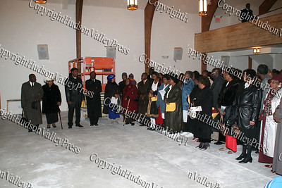 The Mount Carmel Church family prepare to sign the floor at the conrerstone dedication