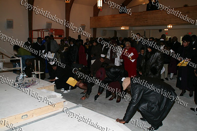 Mount Carmel Church members sign the floor at the cornerstone dedication