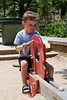 Joey on the see-saw at the Cambridge Common, scene of so many earlier kid pictures...