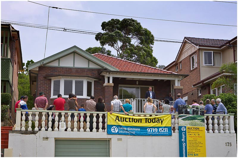 Thompson St., Drummoyne, Saturday December 9th 2006. <br /> <br /> Sydneysiders are property mad, especially when it comes to anything with a water view. With clear views across Five Dock Bay this three bedroom house, in need of renovation, reached $1.65 million at auction today, but failed to sell as the owners had a reserve of $1.7 million and no one was prepared to budge either way. <br /> <br /> <br /> EXIF DATA <br /> Canon 1D Mk II. EF 24-70mm f/2.8L@50mm 1/200s f/13 ISO 200.