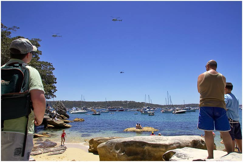 "Steele Point, Vaucluse, Tuesday December 26th 2006.  Boats, people and news helicopters gather prior to the start of the annual Sydney to Hobart yacht race. This is the 62nd year of the international classic event covering 630 nautical miles. Please click <a href=""http://rolexsydneyhobart.com/default.asp?key=521"" target=""_blank""><em><strong>here</strong></em></a> for more information. If you have Google Earth installed, the race can be followed by clicking this <a href=""http://rolexsydneyhobart.com/ge/cyca_rshyr_yachtrace.kml""><em><strong>link</strong></em></a> which is a feed providing live positional information for each yacht.   EXIF DATA  Canon 1D Mk II. EF 17-35mm f/2.8L@17mm 1/125 f/22 ISO 200"