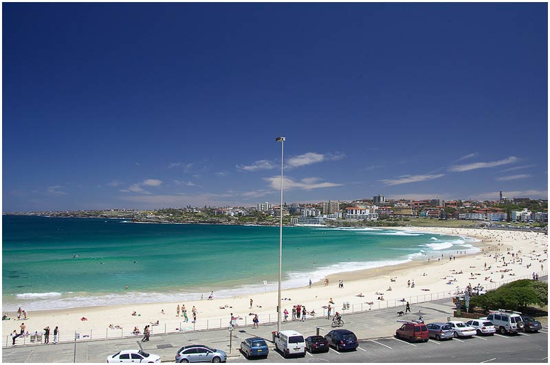"Bondi Beach, Friday December 22nd 2006.  Beautiful weather across Sydney today. On Christmas Day this beach is usually packed with people. This image is part of a large panorama and best viewed <a href=""http://sydneywebcam.smugmug.com/photos/popup.mg?ImageID=118235649&Size=Original&popUp=1"" target=""_blank""><strong><em>here</em></strong></a>.    EXIF DATA  Canon 1D Mk II. EF 17-35mm f/2.8L@25mm 1/125 f/11 ISO 200."