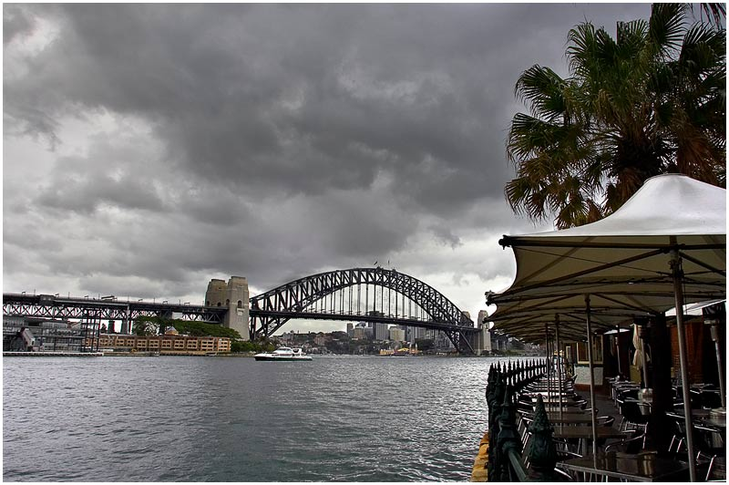 Circular Quay, Tuesday December 12th 2006. <br /> <br /> After yesterday's high temperatures there was a thunderstorm overnight and this is how Sydney looked early this morning with very cool wet weather. <br /> <br /> <br /> EXIF DATA <br /> Canon 1D Mk II. EF 17-35mm f/2.8L@17mm 1/80s f/13 ISO 200.