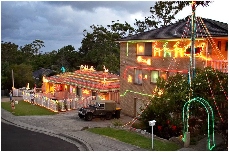 Paling Street, Thornleigh, Sunday December 24th 2006. <br /> <br /> Festive fun or tastelessly tacky? Christmas light displays far more elaborate than this can be found in suburbs all over Sydney. Merry Christmas everyone. <br /> <br /> <br /> EXIF DATA <br /> Canon 1D Mk II. EF 17-35mm f/2.8L@25mm 1/50 f/2.8 ISO 1000.