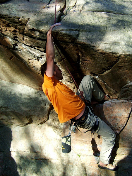 Eric pulls the moves into the overhang on <i>Gagrantua 5.10b</i>.