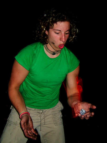 Rachel plays with fire late at night in a campground near Devil's Lake.
