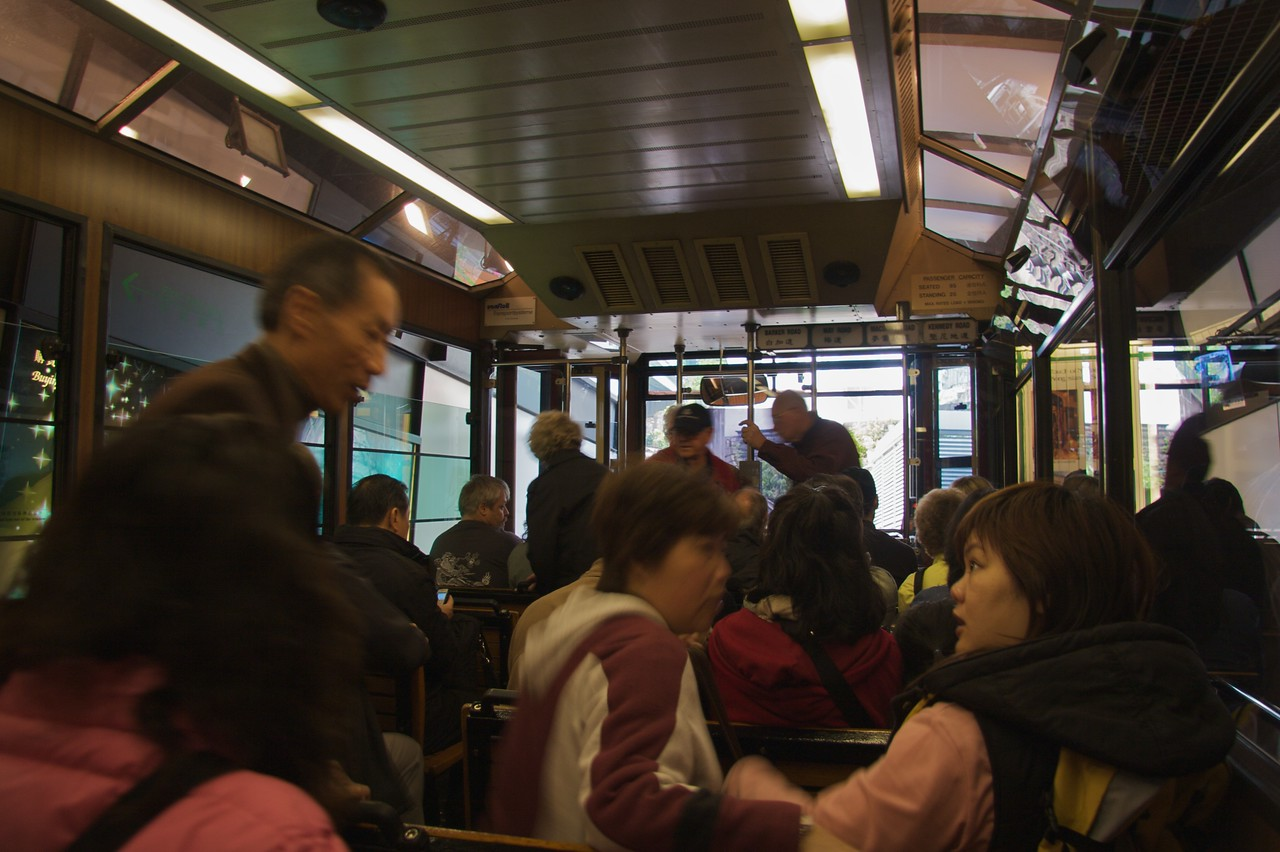 On the Peak Tram • People board the Peak Tram (strictly a funicular railway), ready for the ascent to Victoria Peak.   The tram is the oldest mode of public transport in Hong Kong, having operated without accident continuously since 1888.