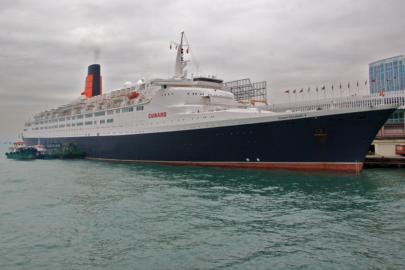 The QE2 • The Queen Elizabeth II was in dock in Hong Kong for a couple of days while I was there. At various points I encountered groups led by guides toting signs emblazoned with 'Cunard'.