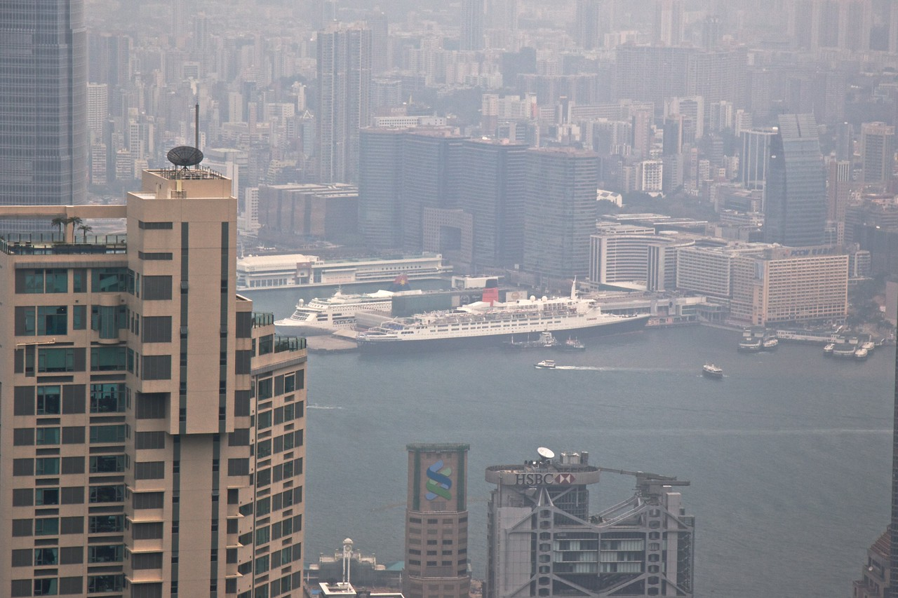 Looking towards Victoria Harbour • The view from The Peak over Victoria Harbour. The QE2 can be seen moored on the Kowloon side of the harbour.