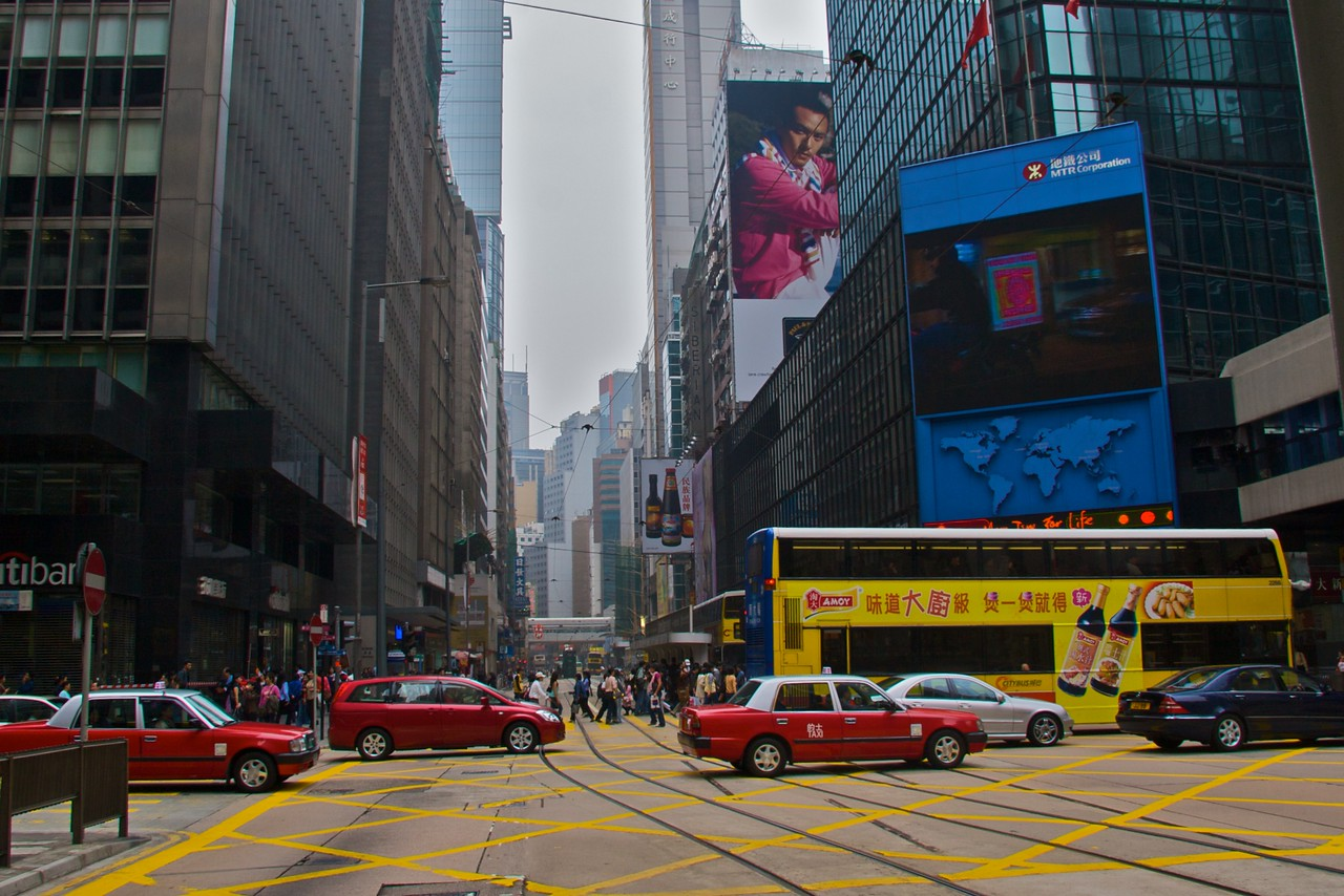 Queen's Road Central • Taxis speed across an intersection with Queen's Road Central in Hong Kong.