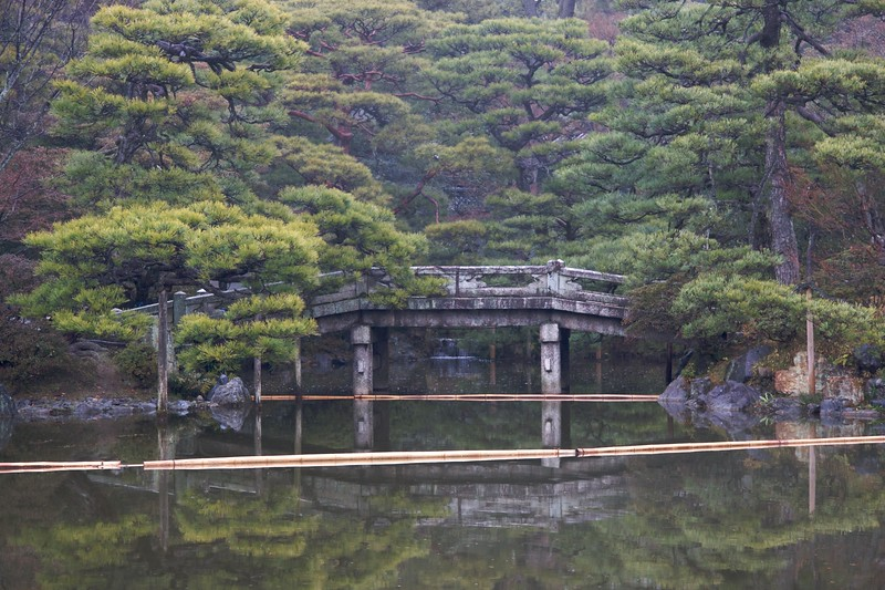 Imperial water-features • The first of the two stroll-gardens we were shown at the Imperial Palace in Kyoto. The garden had an impressive lake in its centre, and was lined with trees.