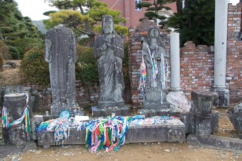 Blasted statues • These statues were outside the original Urakami cathedral in Nagasaki which was destroyed by the atomic bomb blast. They were blackened and disfigured by the blast of the bomb.