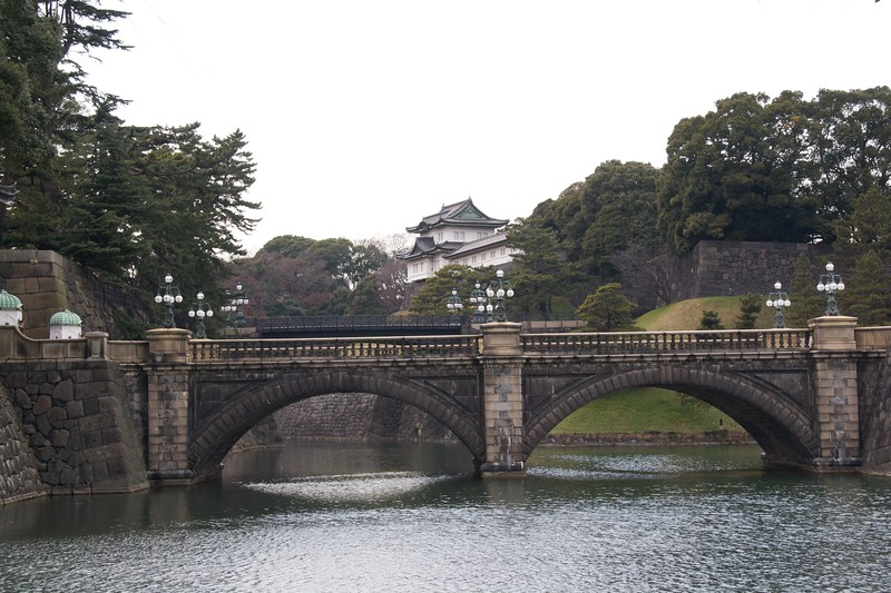 Imperial bridge • A stone bridge across the moat surrounding the grounds of the Imperial Palace in Tokyo.