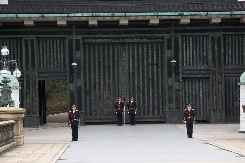 Changing of the Guard • As I walked around the public grounds of the Imperial Palace in Tokyo, I saw the changing of the guard outisde this gate, which encloses the palace proper.