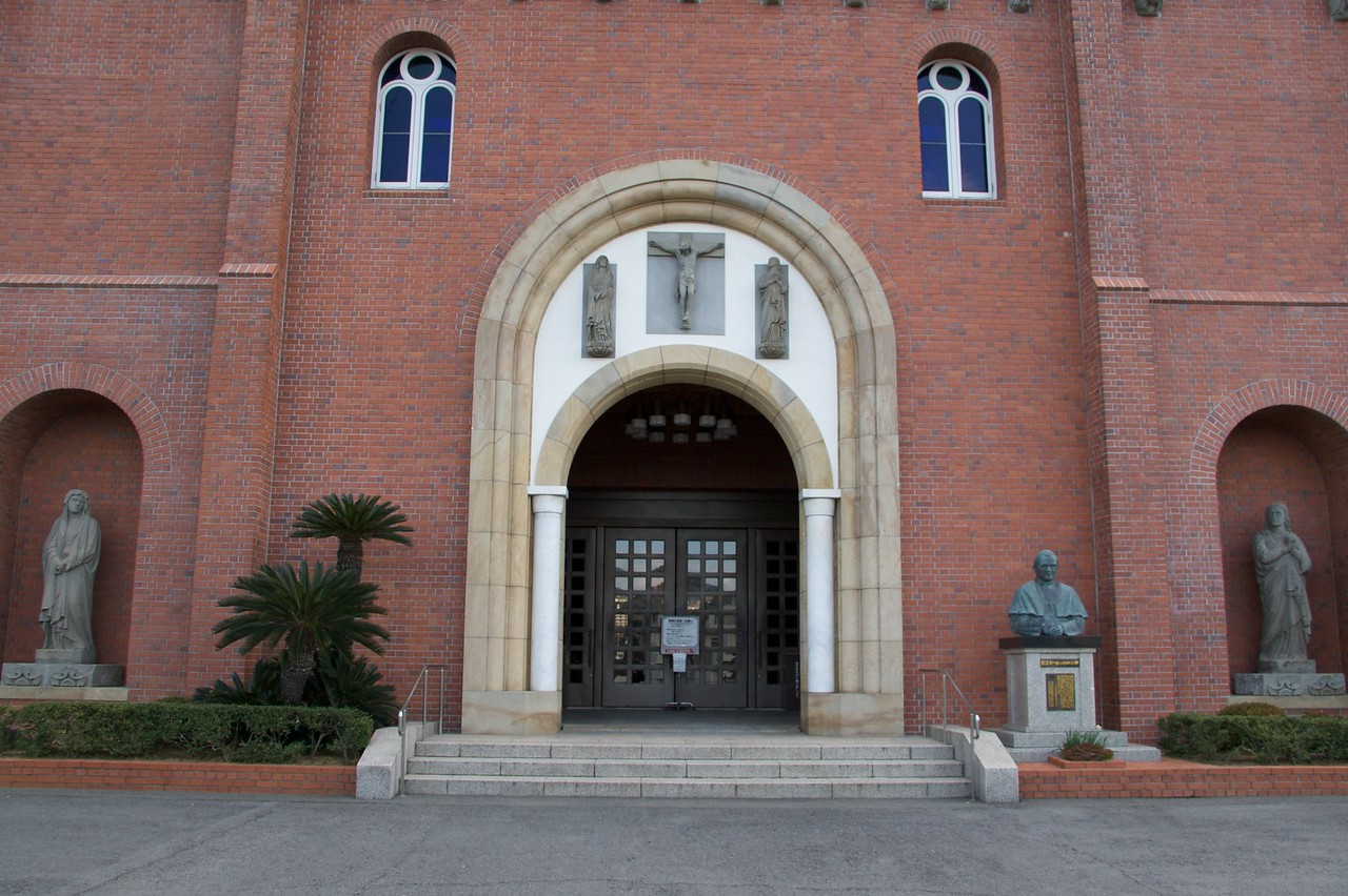 Cathedral doorway • The entrance to Urakami cathedral in Nagasaki. There is a bust of Pope John Paul II at the right-hand side of the door. He visited Nagasaki in 1982.