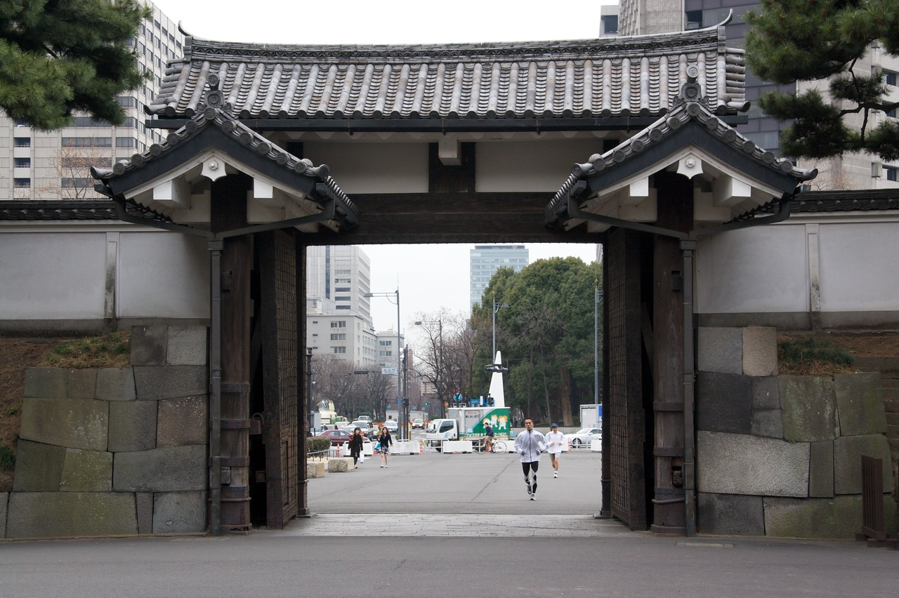 Imperial Palace entrance • Looking out through the gateway into the grounds which are open to the public of the Imperial Palace in Tokyo.