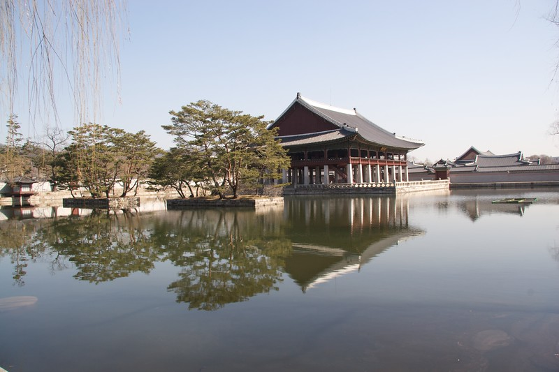 Gyeonghoeru • Gyeonghoeru, the banquet-house of Gyeongbokgung.   It sits atop a body of water, accessible by a path from the bank on the other side.