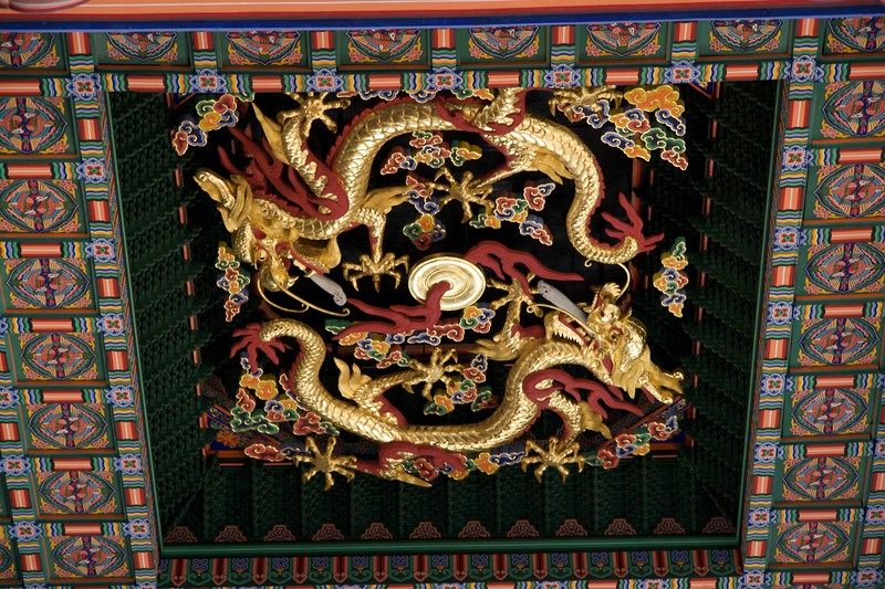 Here be dragons • Dragons adorn the ceiling inside the Geunjeongjeon at Gyeongbokgung.