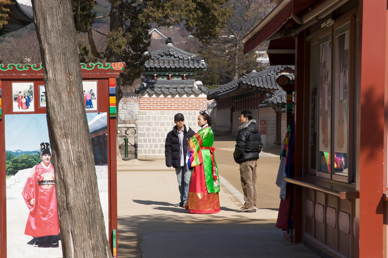 Dressed up • A woman is dressed in traditional formal Korean clothing on the paths inside the Gyeongbokgung.