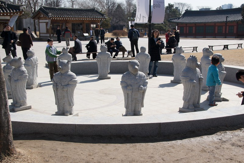 Statues • Shamanist stone statues with the heads of various animals standing outside the National Palace Museum of Korea, which is inside the grounds of the Gyeongbokgung.