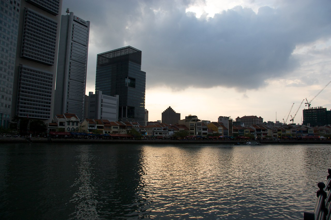 Sunset over Singapore • The view across Singapore River at sunset.