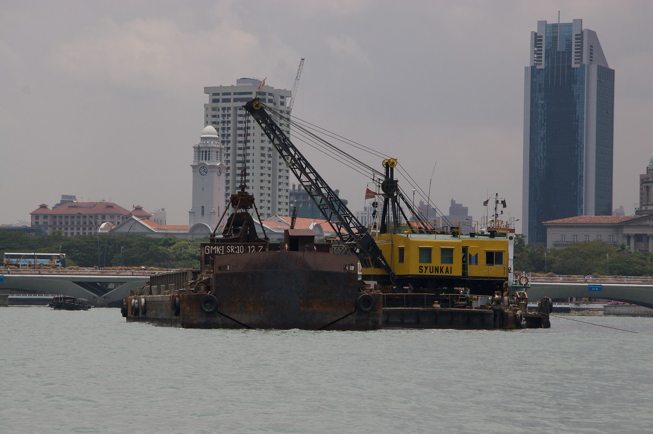 Construction barge • A construction barge on Singapore River, preparing a man-made peninsula on which they are bulding a new casino.