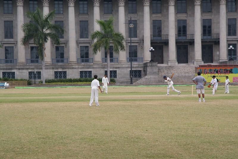 Cricket on the Padang • Schoolboy cricket on the Padang: not, of course, in the famous Singapore Cricket Club (of which I'm not a member) but on the public recreation ground.