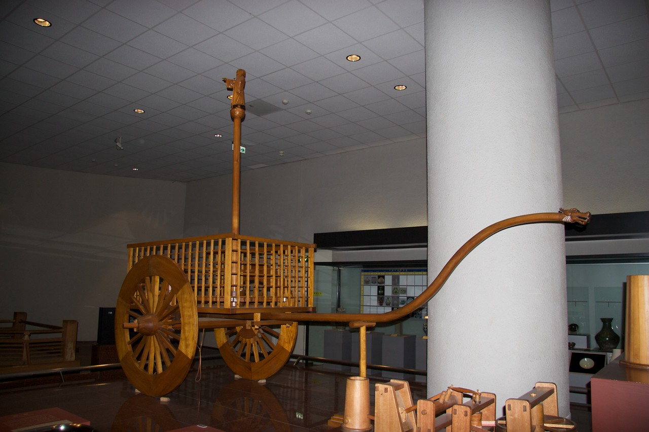 The south-pointing wagon • At the National Museum of Natural Science, Taichung.  A series of cogs in the wagon ensures that the wooden monk on top of the pole always points to the south, even when the cart turns.