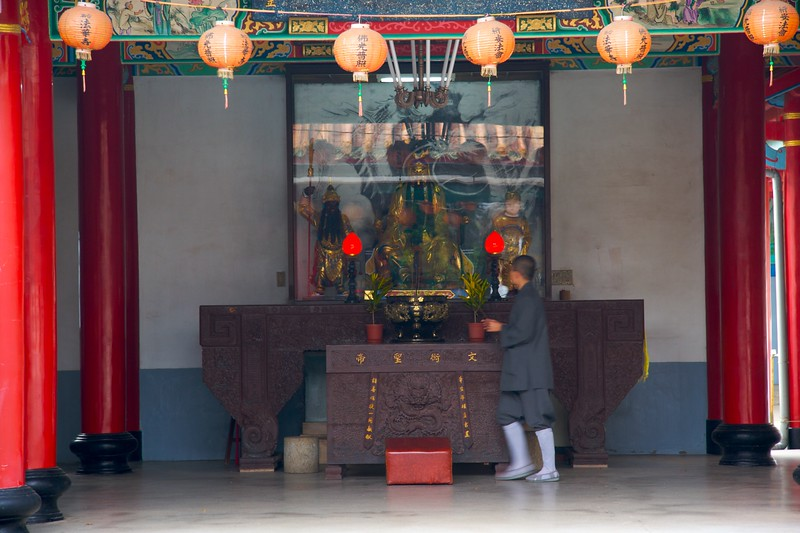 Attending to the incense • A boy-monk at work at Fahua Monastery, Tainan.