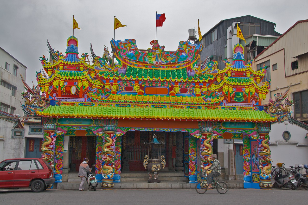 Temple of the city god • The front of the Temple of the city god, Tainan.  It really is those colours: this photo looks as if the colours have been filled in in Photoshop, but I can assure you nothing of the sort has taken place!  If the roof looks a bit like a painting, that's because it <strong>is</strong> a painting—the front of the temple is enclosed by a wooden hoarding.