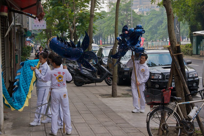 Dragon • I saw these children carrying two long velvet dragons along the pavement as I came back from Mass in Taipei on Sunday.