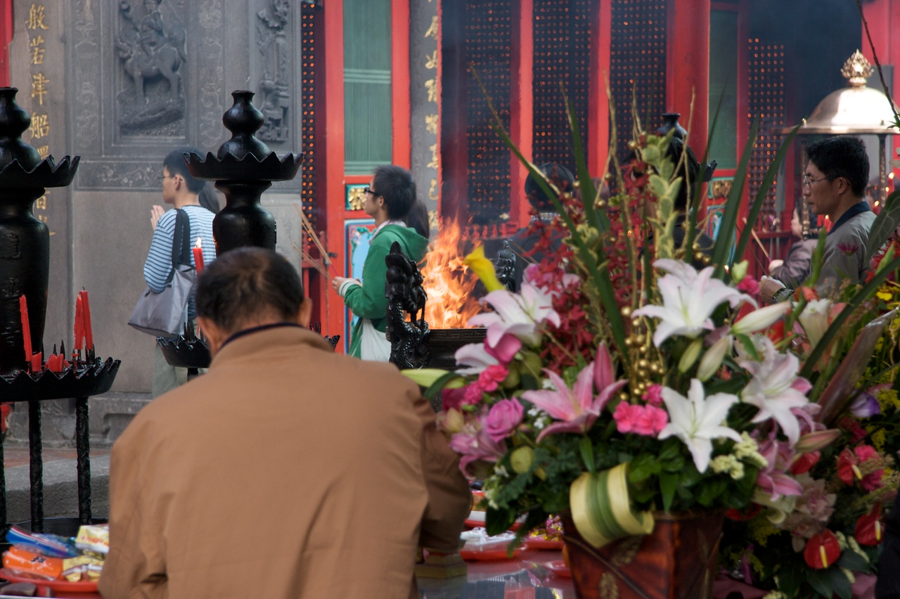 The thurible flares up • I wasn't totally certain if this fire in the back courtyard of Longshan Temple was intentional or not. I had noticed people throwing what looked like bits of paper (intentions?) into the burner so I suppose this was an expected result.
