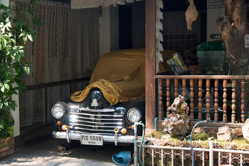 Car • A classic car carefully covered in a shed at Wat Phra Singh in Chiang Mai.