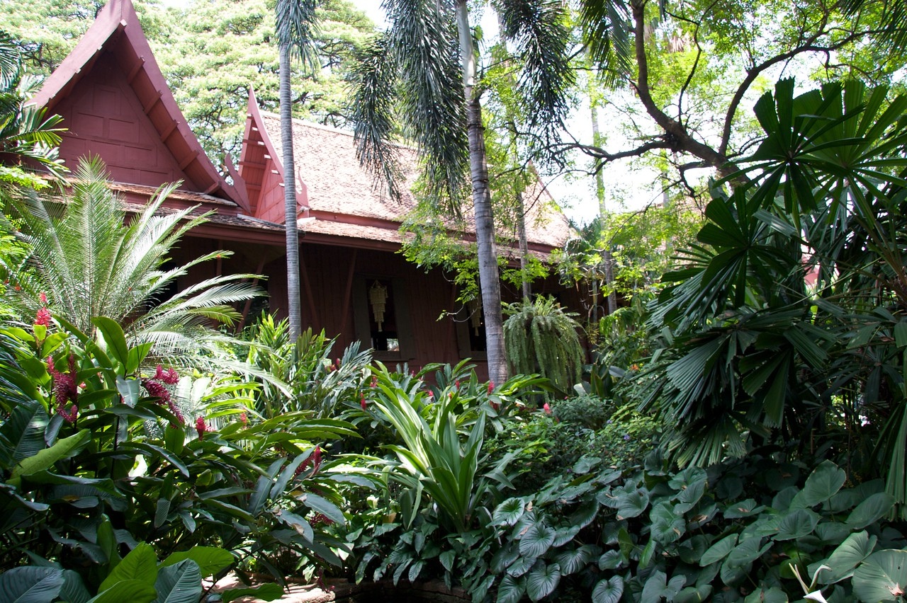 Jim Thompson's House • Jim Thompson's leafy garden in the middle of Bangkok. Jim Thompson was an American fabric designer (born 1906) who revived the Thai silk industry. He developed a magnificent family home in Bangkok, but disappeared without a trace in 1967. Theories abound about his disappearance, but it has been linked to his earlier work as an American military intelligence officer in the Office of Strategic Services (which came before the CIA), posted to Bangkok.
