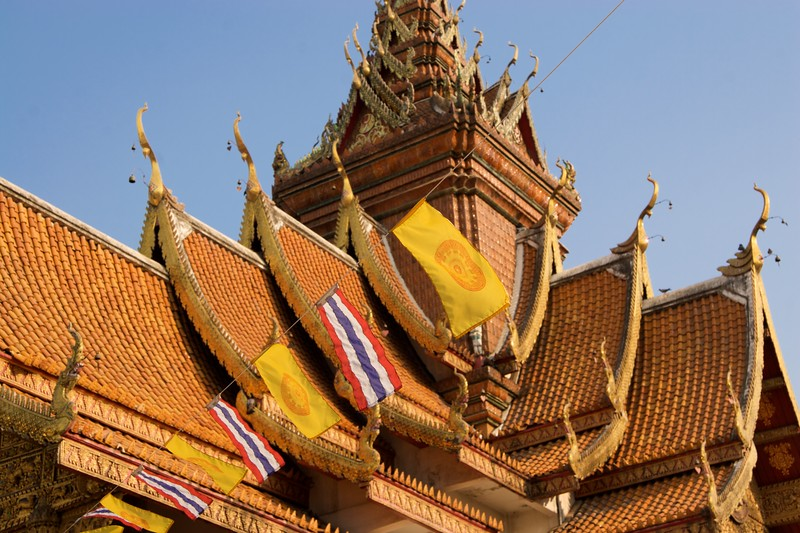 Wat Bupparam • Flags hang outside Wat Bupparam in Chiang Mai.