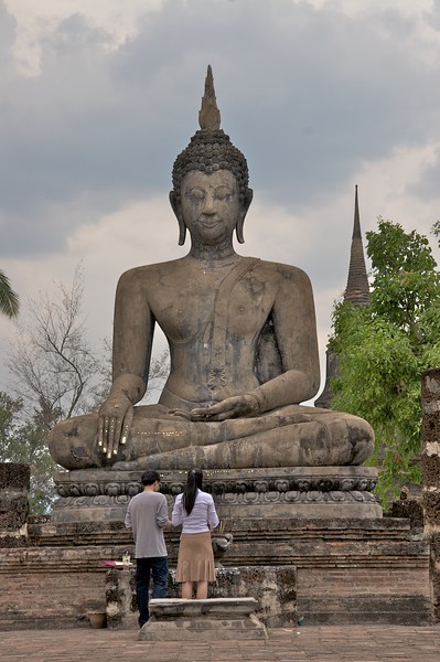 Buddha • A large stone Buddha in Sukhothai Historical Park. Although the surroundings are ruins, the authorities evidently see fit to keep the Buddha's golden paint fresh.