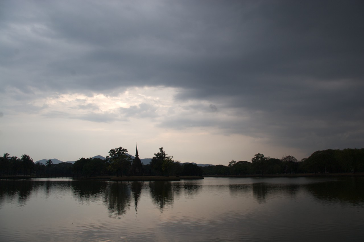 After the rain • The clouds passed over Sukhothai Historical Park; since it was the end of the day everything was already in shadow with the sun getting ever lower in the sky.