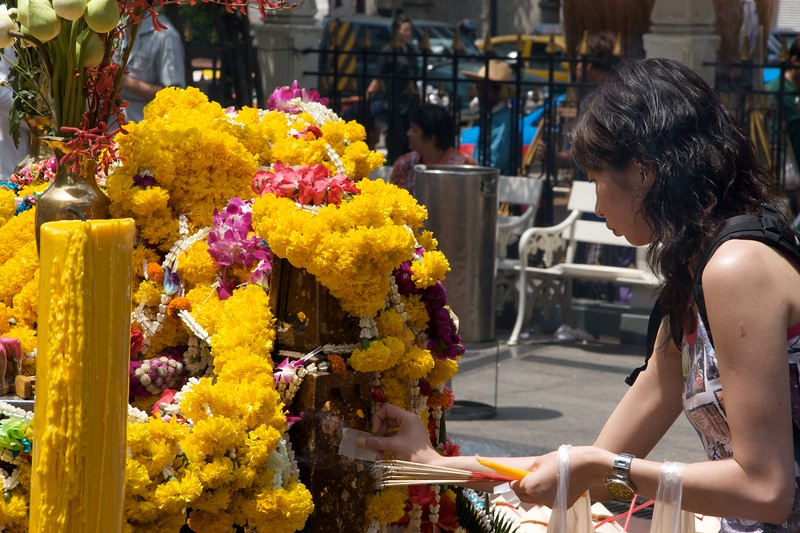 Offering • A woman makes an offering at the Erawan Shrine in Bangkok.