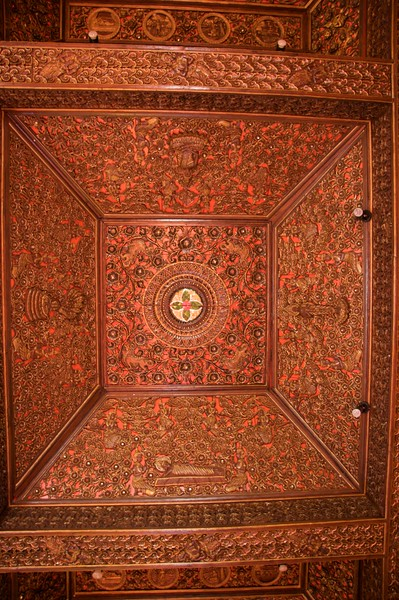 Ceiling • The wood-panelled ceiling at Wat Bupparam in Chiang Mai.