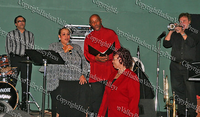 """Consuelo Hill sings a """"song for a friends"""" while in concert at It's All Good Restaurant at 90 Broadway in Newburgh, NY"""
