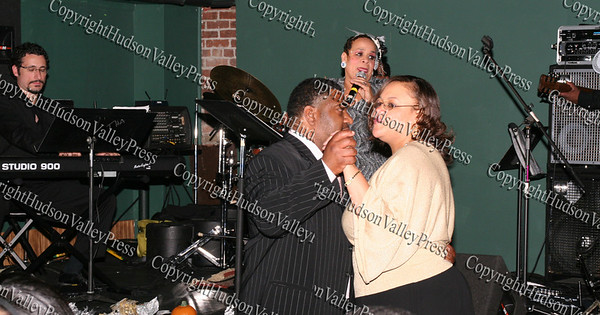 Consuelo Hill sings for Pam and Ezra Caldwell during her concert at the It's All Good Restaurant in Newburgh, NY