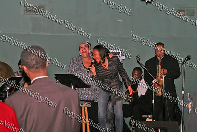 Consuelo Hill and Tymisha Stevens sing together on stage at It's All Good Restaurant at 90 Broadway in Newburgh