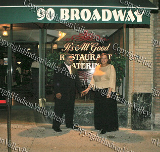 Pam and Ezra Caldwell in front of the It's All Good Restaurant in Newburgh, NY