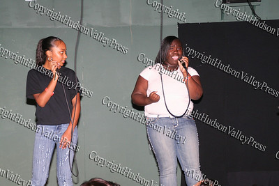 Jennifer Lavigat and Shatiera Towles sing during the talent show