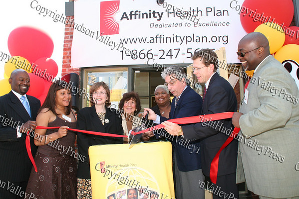 Kel Ritter, Rhonda Morriss, Barbara Kellman, Regina Angelo, Denise Rogers, Nicholas Valentine, Max Menge and Darrel Hutchinson cut the ribbon