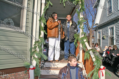 Virgen, Daniel and Noel Segarra on the steps of their new home